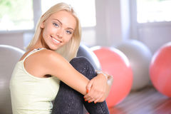 Blond girl with a fitness ball Stock Photography