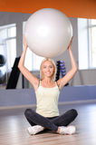 Blond girl with a fitness ball Stock Photo