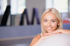 Blond girl with a fitness ball Stock Photos