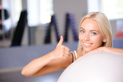 Blond girl with a fitness ball Stock Image
