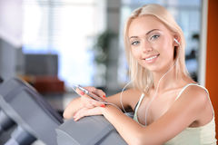 Blond girl in a fitness club Royalty Free Stock Photography