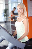 Blond girl in a fitness club Royalty Free Stock Photo