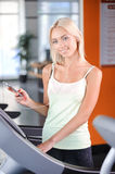 Blond girl in a fitness club Stock Photography