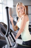 Blond girl in a fitness club Stock Images