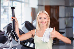 Blond girl in a fitness club Royalty Free Stock Image