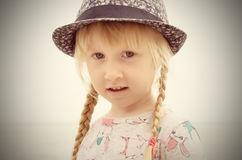 Blond Girl with Floral Hat Looking Into Distance Royalty Free Stock Photography