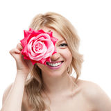 Blond girl with flower Royalty Free Stock Images