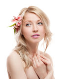 Blond girl with flower Stock Image