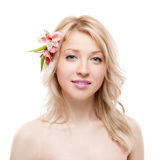 Blond girl with flower Royalty Free Stock Photography