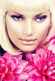 Blond Girl with Flowers Royalty Free Stock Image