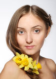 Blond girl with flowers in her hair Royalty Free Stock Image