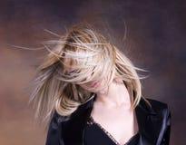 Blond girl fluttering hair stock photo