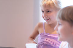Blond girl with a friend Stock Photo