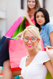 Blond Girl with Friends Shopping Royalty Free Stock Image