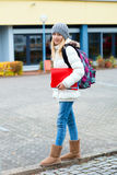Blond girl in front of school building Stock Photos