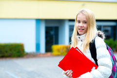 Blond girl in front of school building Royalty Free Stock Image