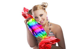 Blond girl funny playing with candy Royalty Free Stock Photography