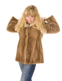 Blond girl in fur coat Stock Photo