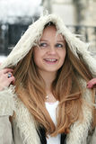 Blond girl in fur coat Royalty Free Stock Images