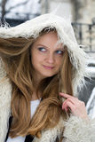 Blond girl in fur coat Royalty Free Stock Photo