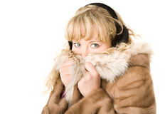 Blond girl in fur headphones Royalty Free Stock Images