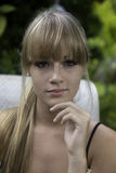 Blond girl garden portrait Royalty Free Stock Photo