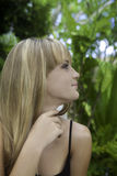 Blond girl garden portrait Royalty Free Stock Photography