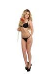 Blond girl with gerbera flower Stock Photos