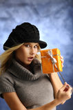 Blond girl with a gift Stock Photos