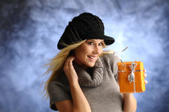 Blond girl with a gift Royalty Free Stock Image