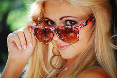 Blond girl in glasses Royalty Free Stock Images
