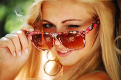 Blond girl in glasses Royalty Free Stock Photos