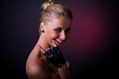 Blond girl with gloves Stock Images