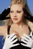 Blond girl with a gloves Royalty Free Stock Photos