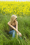 Blond girl on the grass stock photo