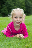A blond girl in the grass Royalty Free Stock Images