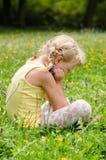 Blond girl on grass Stock Image