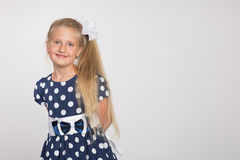 Blond girl on a gray background Royalty Free Stock Image