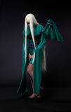 Blond girl in green fury cosplay character Stock Photos