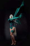 Blond girl in green fury cosplay character Royalty Free Stock Image