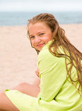 Blond girl with green towel Royalty Free Stock Photos