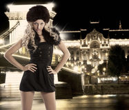 Blond girl with hand on hips and fur hat Stock Photography