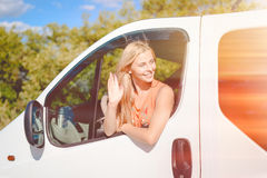 Blond girl happy smiling and greeting someone from Royalty Free Stock Photo