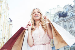 Blond girl having fun after shopping Royalty Free Stock Images