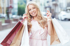Blond girl having fun after shopping Stock Photography
