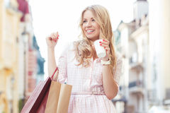 Blond girl having fun after shopping Royalty Free Stock Image