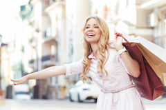 Blond girl having fun after shopping Stock Images