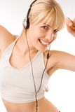 Blond girl with headphones Stock Images