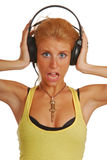 Blond girl with headphones Stock Photos