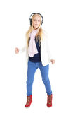 Blond girl with a headphones. Listening to music and dancing. Stock Image